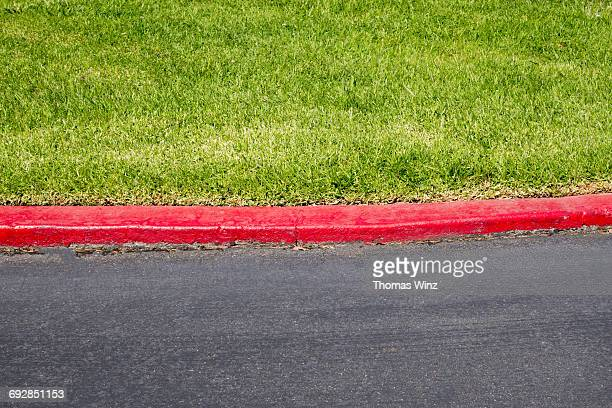 red curb at garage entrance - curb stock pictures, royalty-free photos & images
