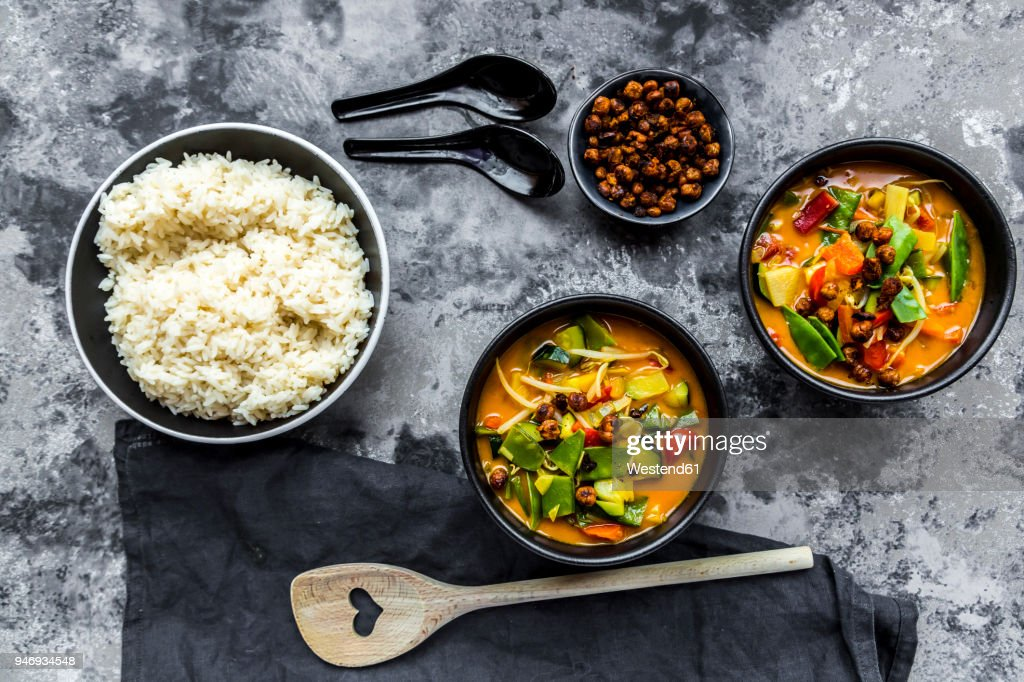 Red curry in bowls, rice and roasted chickpeas : Stock Photo