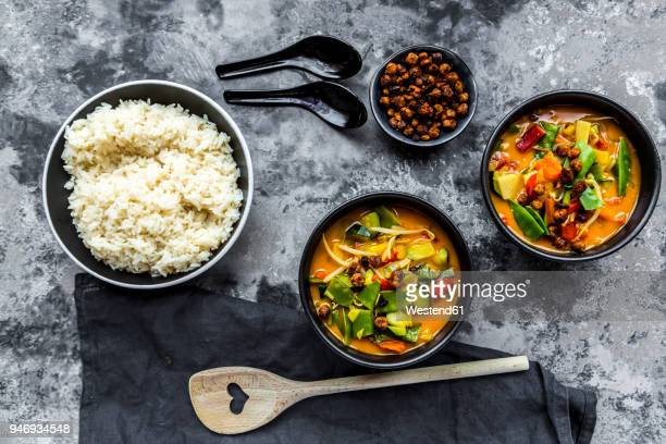 Red curry in bowls, rice and roasted chickpeas