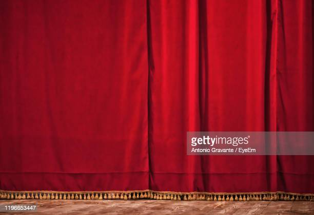 red curtain on stage - stage curtain stock pictures, royalty-free photos & images