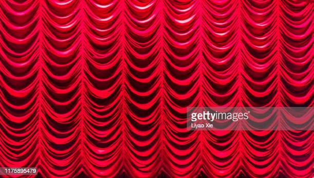 red curtain - liyao xie stock pictures, royalty-free photos & images