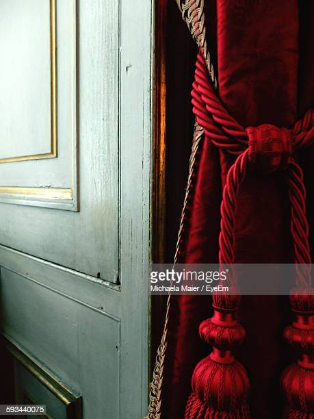 Red Curtain Tied By Door