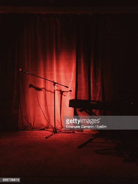 Red Curtains With Microphone And Piano