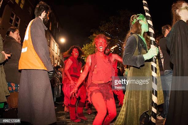 red dancers at the samhuinn fire festival, edinburgh - samhuinn stock photos and pictures