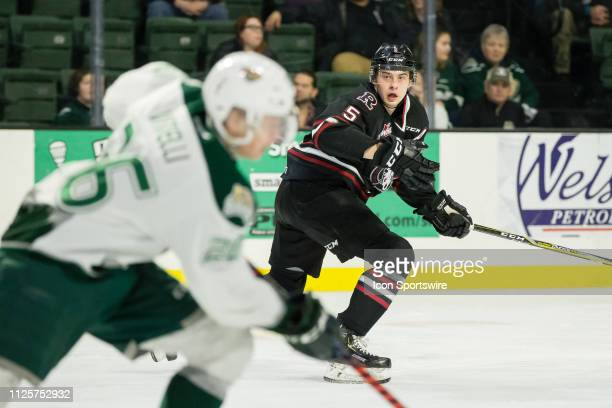 Red Deer Rebels defenseman Dawson Barteaux shadows Everett Silvertips forward Reece Vitelli down the ice in the first period of a game between the...