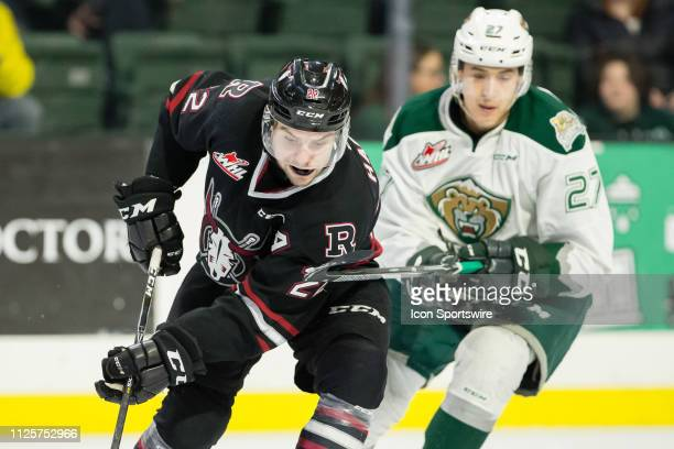 Red Deer Rebels forward Brandon Hagel uses his body to shield the puck from Everett Silvertips forward Jalen Price in the second period during a game...