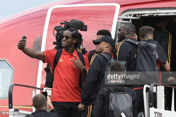 Red Devils Belgium's national football team player Michy Batshuayi takes a selfie picture with his teammates Moussa Dembele Vincent Kompany forward...