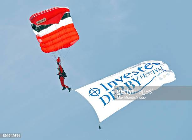 A Red Devils parachutist takes part in a display during the Investec Derby Festival at Epsom Racecourse on June 3 2017 in Epsom England