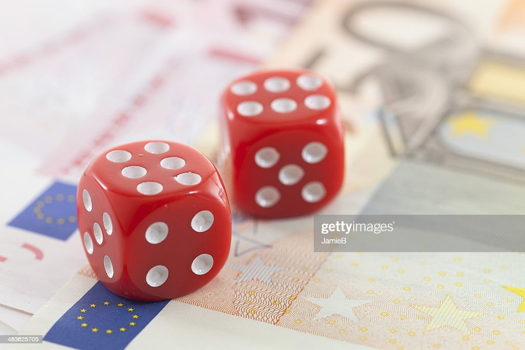 Red Dice on Euro banknotes : Stock Photo