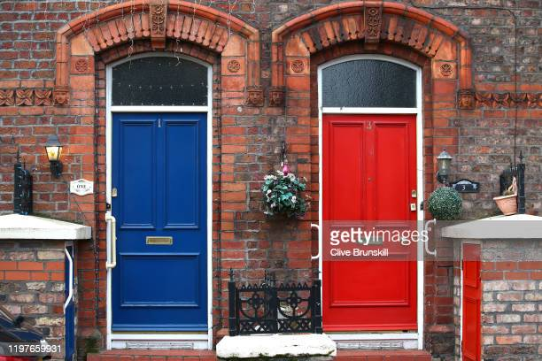 Red door and a blue door are seen on houses near the stadium prior to the FA Cup Third Round match between Liverpool and Everton at Anfield on...