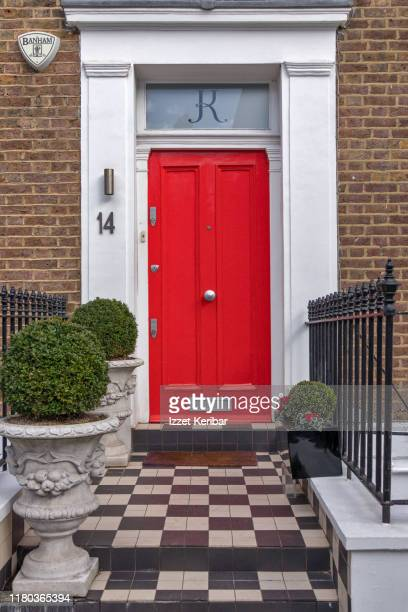 red door and checker design basement, london house, uk - brick house stock pictures, royalty-free photos & images