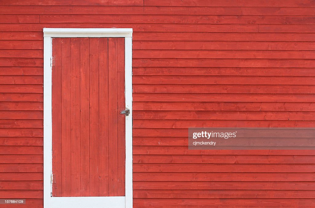 red door and exterior clapboard wall : Stock Photo