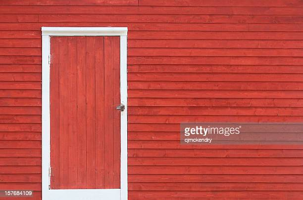 red door and exterior clapboard wall