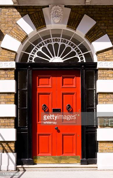 red door on london home framed in black - regency style stock photos and pictures
