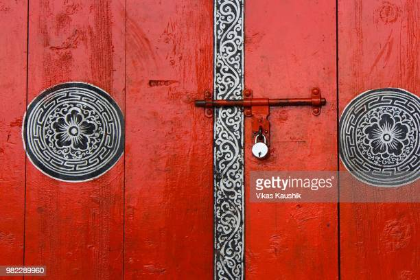 a red door with traditional patterns in mussoorie, uttarakhand, india - uttarakhand stock pictures, royalty-free photos & images