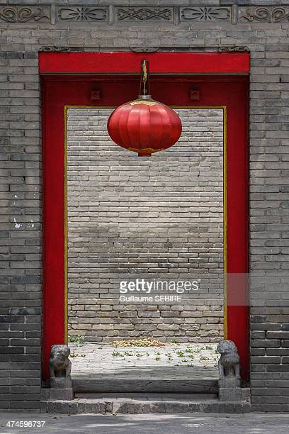 Red Doorway with Chinese lantern and grey bricks