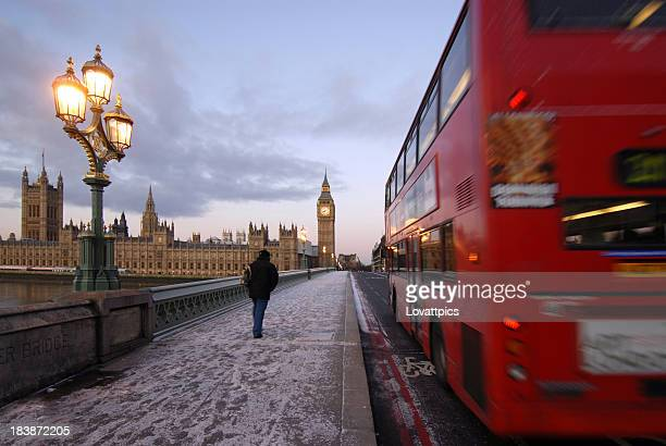 Red double decker bus on Westminster bridge, London