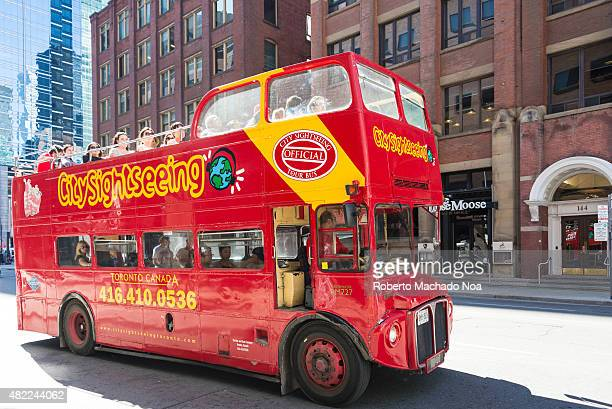 Red double decker tour bus Several people can be seen in the windows of this bus in the style of the famous London doubledeckers enjoying the sights...