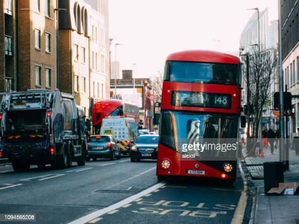 Red double-decker bus in London city center street traffic