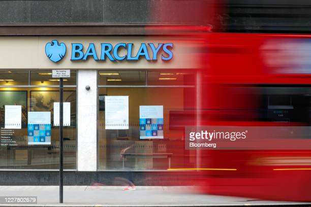 A red doubledecker bus passes a Barclays Plc bank branch in London UK on Monday July 27 2020 The Treasury is in talks with the UK's largest banks...