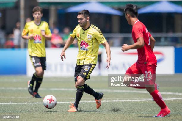 Red Dragons' Chung Wai Keung competes with Wellington Phoenix' Oliver Whyte during their Main Tournament Plate SemiFinal match part of the HKFC Citi...