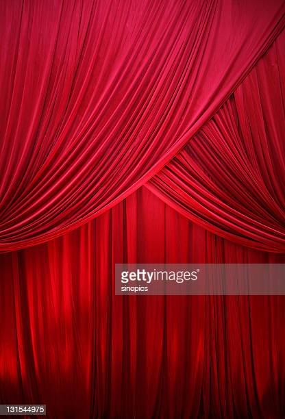 red drape - spotlight film stock photos and pictures