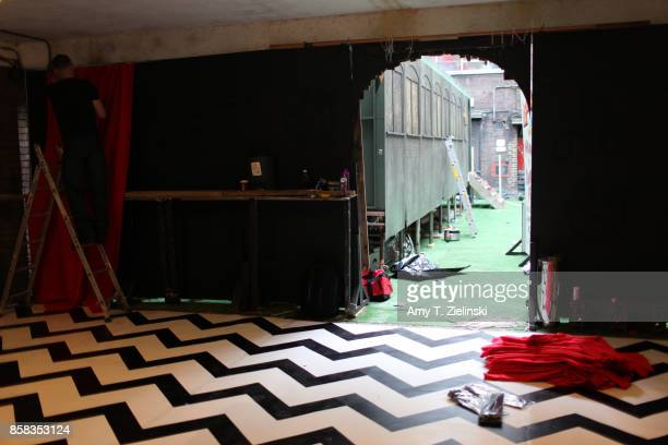 Red drapes are hung while the black and white chevron flooring is constructed the day before the Twin Peaks UK Festival 2017 at Hornsey Town Hall...