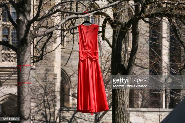 TORONTO ON MARCH 21 Red dresses can be seen hanging from the trees on the University of Toronto campus this week as part of the Red Dress Project...