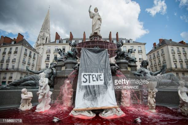 TOPSHOT A red dye had been displayed in the fountain of the Place Royale on July 30 2019 in the western French city of Nantes a day after the body of...