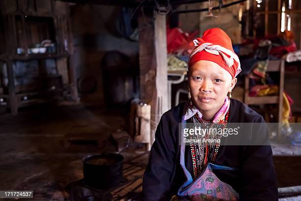 Red Dzao woman, wearing red headdress and traditional dress in the village of Ta Phin near Sapa in Northern Vietnam. Dress, Vietnam, Indigenous...