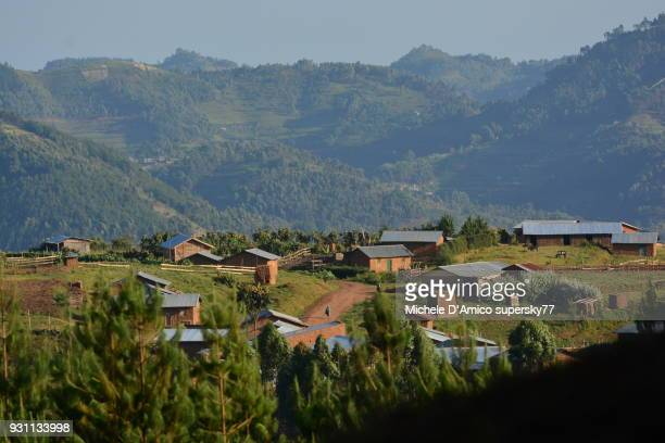 red earth village lost in the green - uganda stock pictures, royalty-free photos & images
