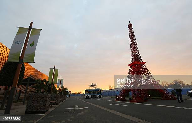 A red Eiffel tower replica statue stands as the sunrises during the United Nations COP21 climate summit at Le Bourget in Paris France on Thursday Dec...
