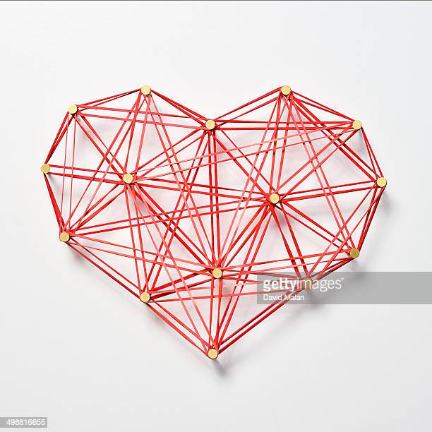 Red elastic bands forming a heart shape