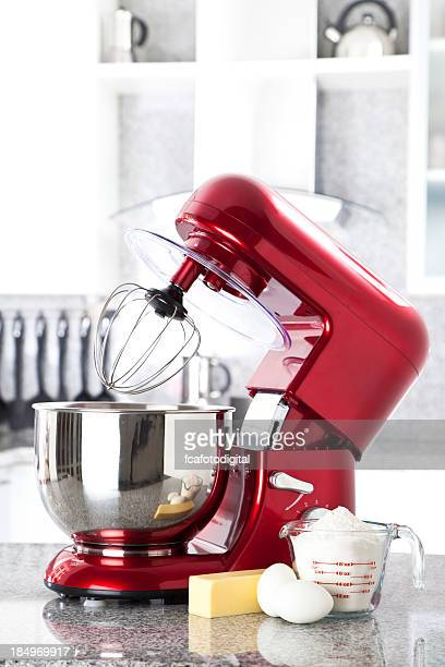Red electric stand mixer on kitchen counter top