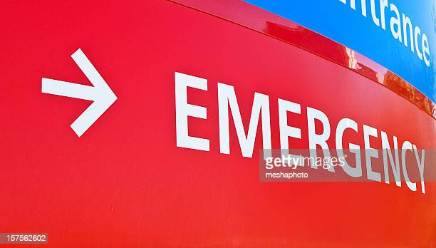 A red emergency room sign for a hospital