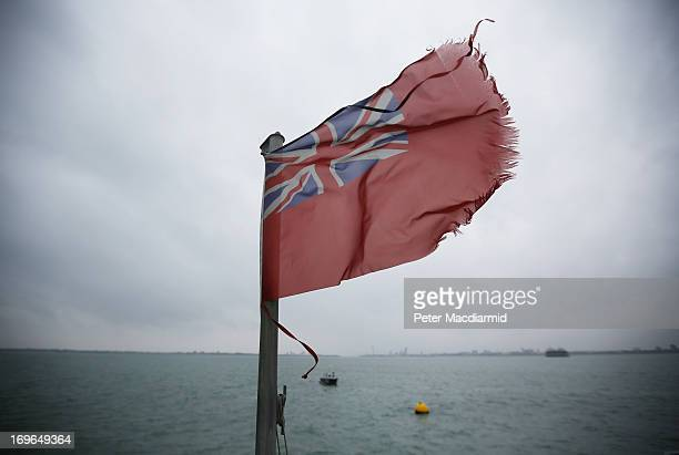 A red ensign flies on a ship at the location of the sinking of the Mary Rose marked by a yellow buoy on May 30 2013 in the Solent off Portsmouth...