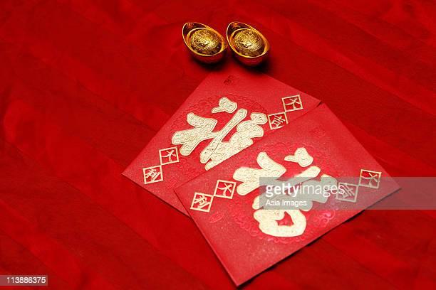 red envelope, (Hong Bao) and gold ingot
