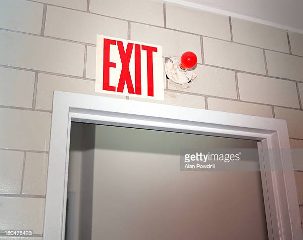 Red Exit sign above doorway