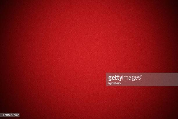 Red fabric texture background with spotlight