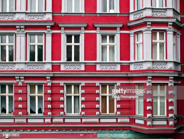 Red facade of residential building in the district of Kreuzberg in Berlin, Germany