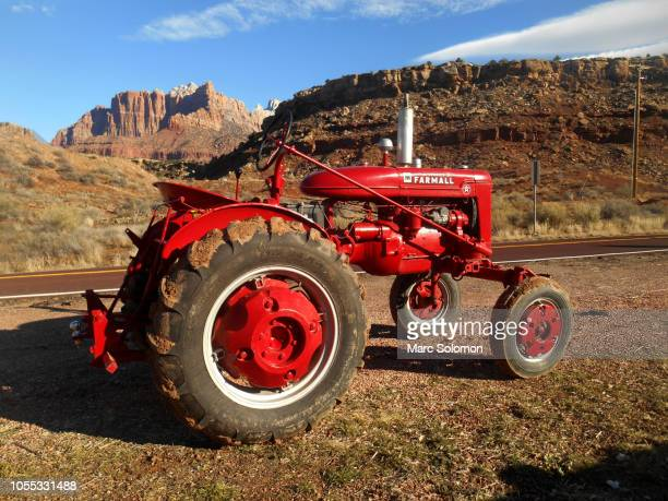 Red Farmall tractor along highway 9 Utah