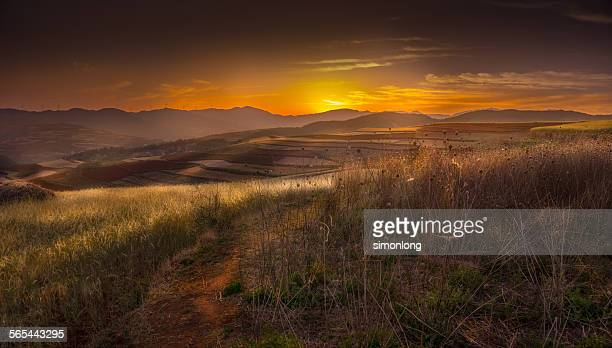 Red farmland with sunset Dongchuan, China