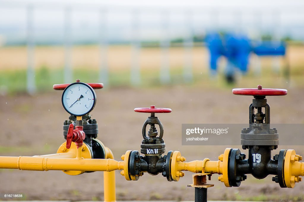 Red faucets with steel pipe in natural gas treatment plant : Stock Photo