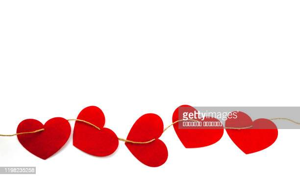 red felt hearts on twine rope white background close up view. valentine's day greeting card concept. - border stock pictures, royalty-free photos & images