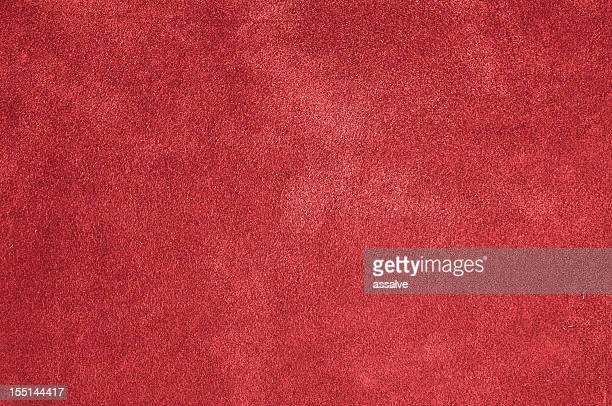 red felt, plush, carpet or velvet background - tapijt stockfoto's en -beelden