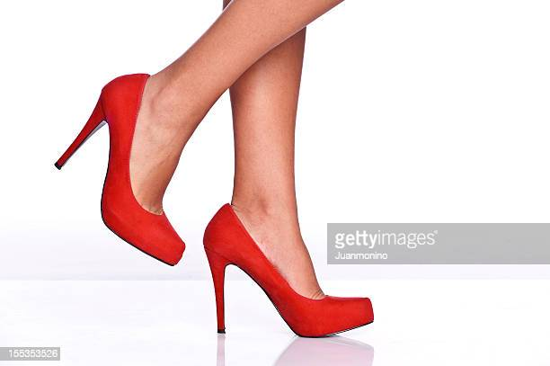 red female shoes - beautiful legs in high heels stock photos and pictures