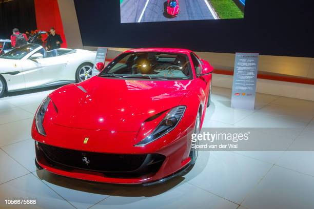 Red Ferrari 812 Superfast front midengine rearwheeldrive grand tourer sports car on display at Brussels Expo on January 10 2018 in Brussels Belgium...