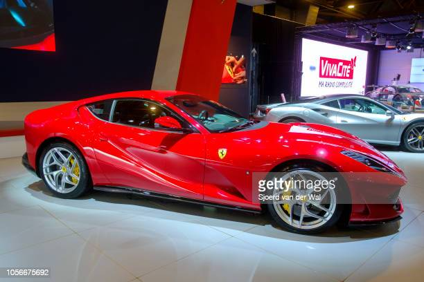 Red Ferrari 812 Superfastfront midengine rearwheeldrivegrand tourer sports car on display at Brussels Expo on January 10 2018 in Brussels Belgium...