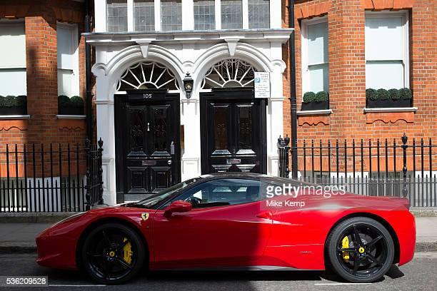 Red Ferrari supercar parked near Sloane Square in Chelsea In a selected few boroughs of West London wealth has changed over the last couple of...