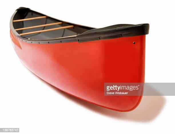 A red fiberglass canoe